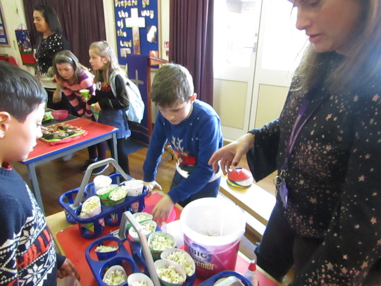 The entrepreneurs of Year 5 sold Christmas cones of popcorn for the fair.