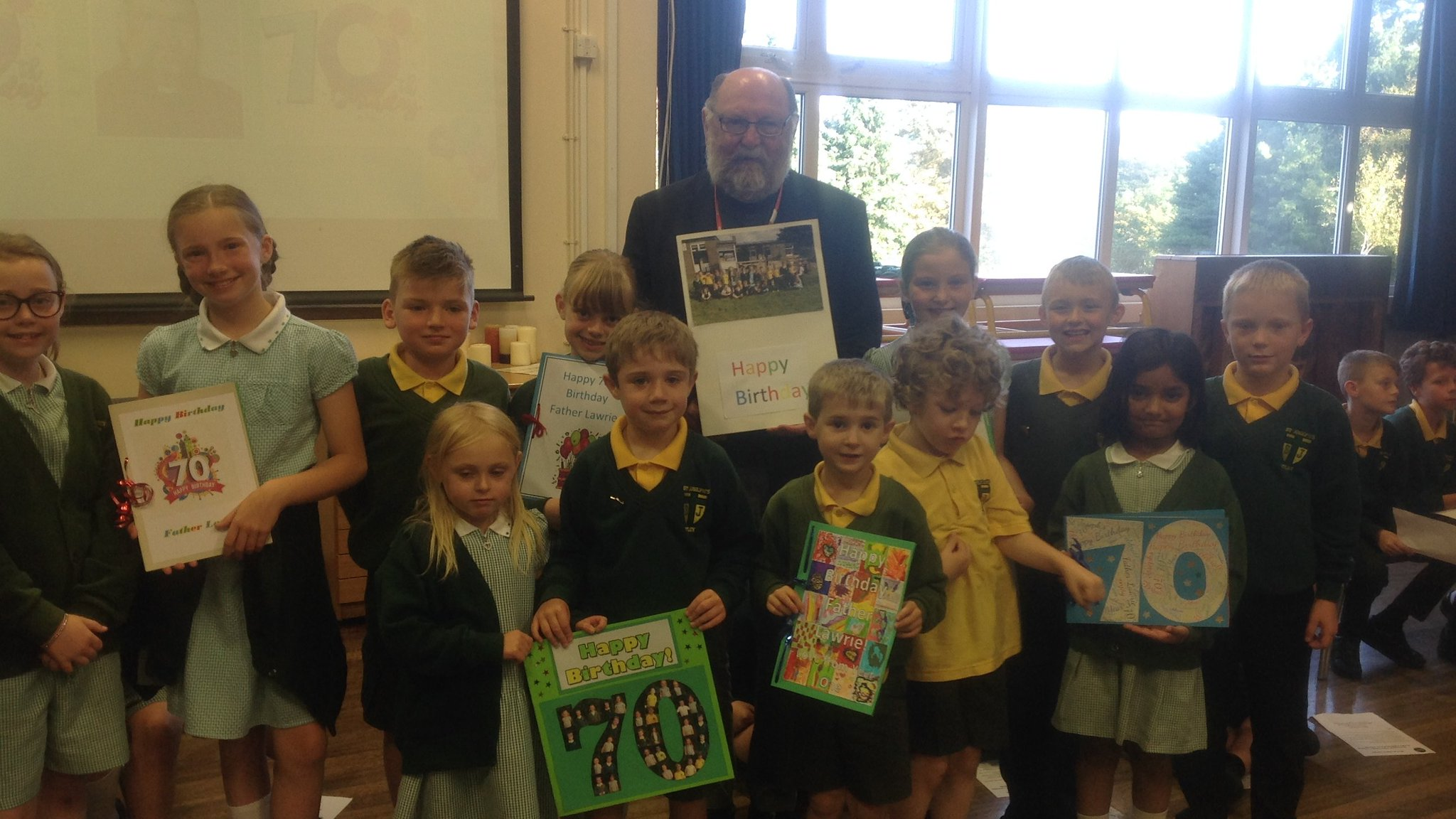 Commemorative photo of Father Lawrie and children from each class