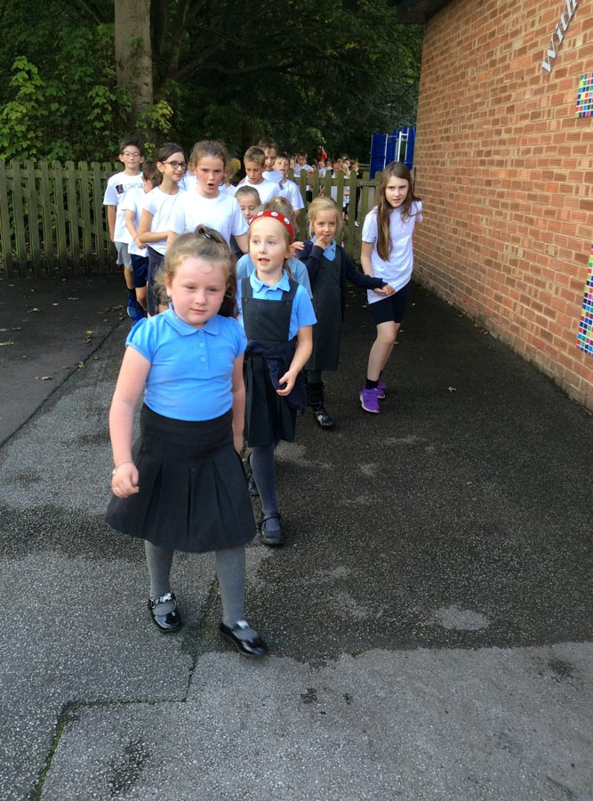 Taking part in the mile walk event