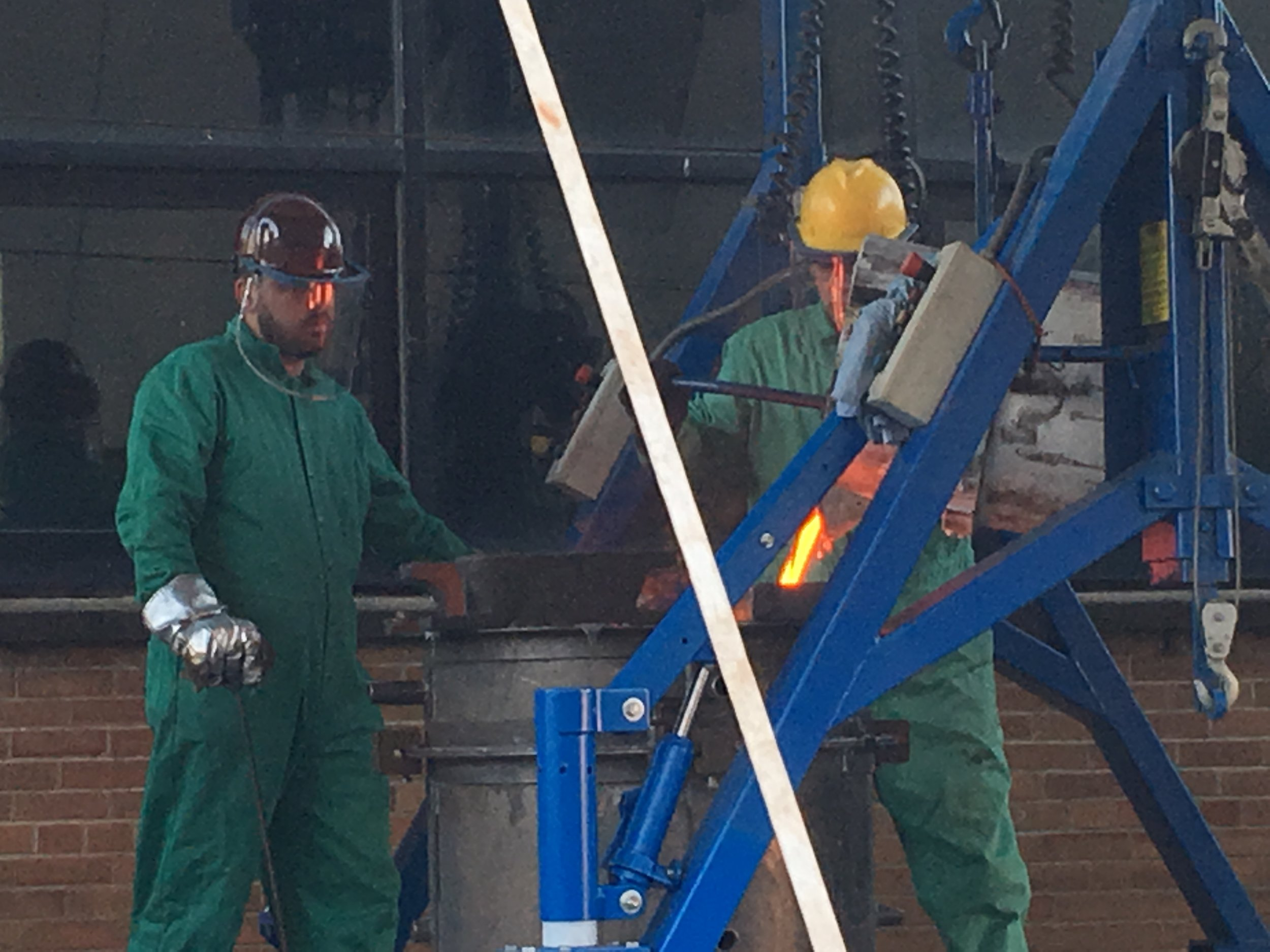 The molten bronze is poured into the mold. The mold will be opened in a few days.
