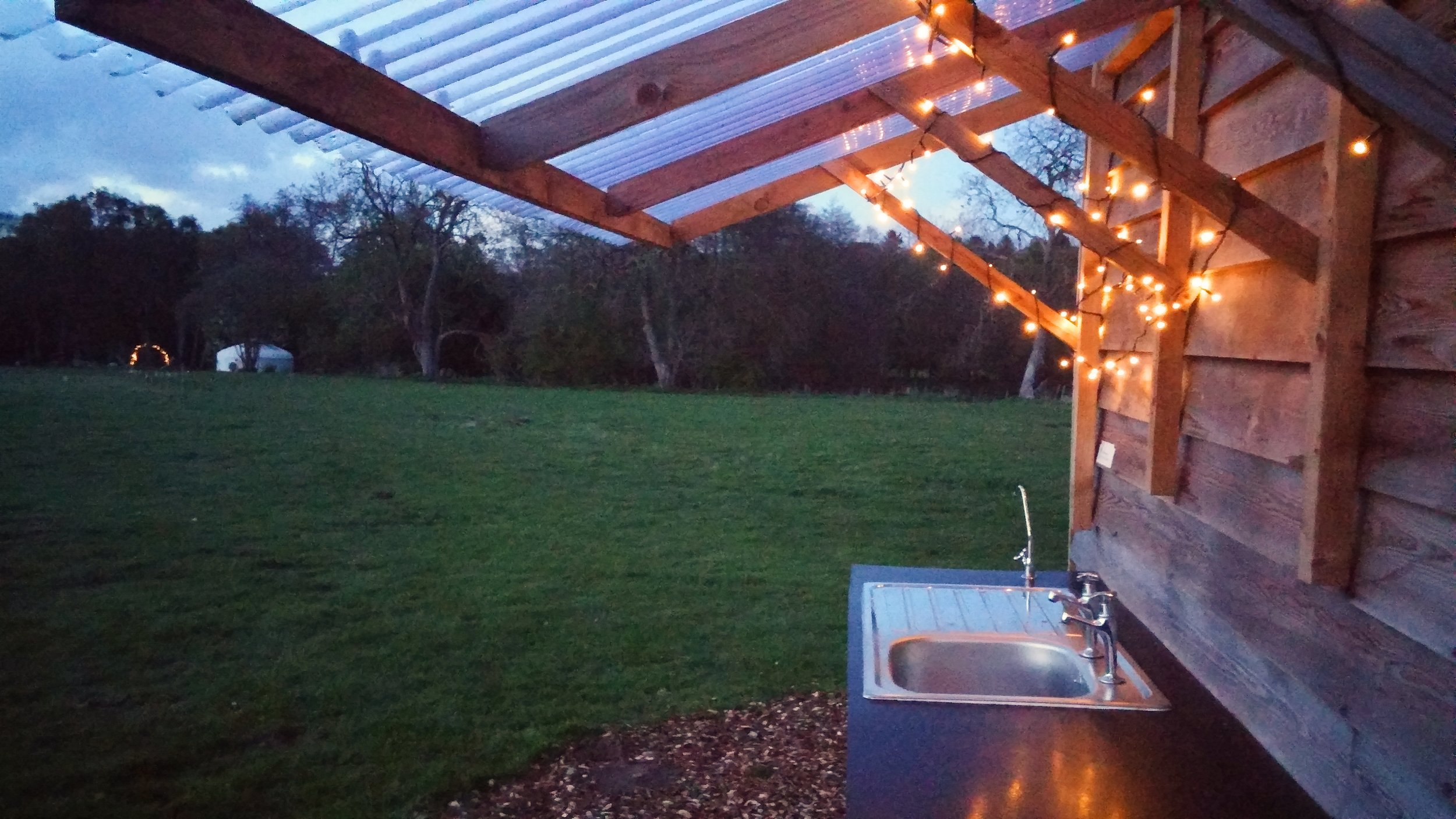 washing up area with fairy lights.jpg
