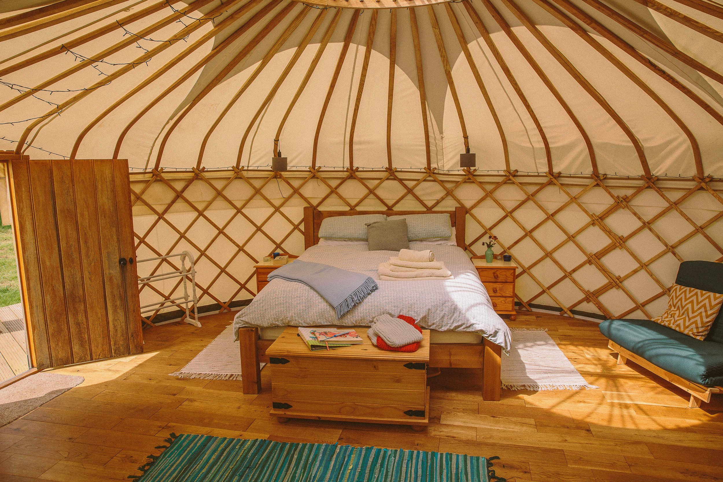 Inside Oak Tree Yurt - luxury and comfort with a king size bed