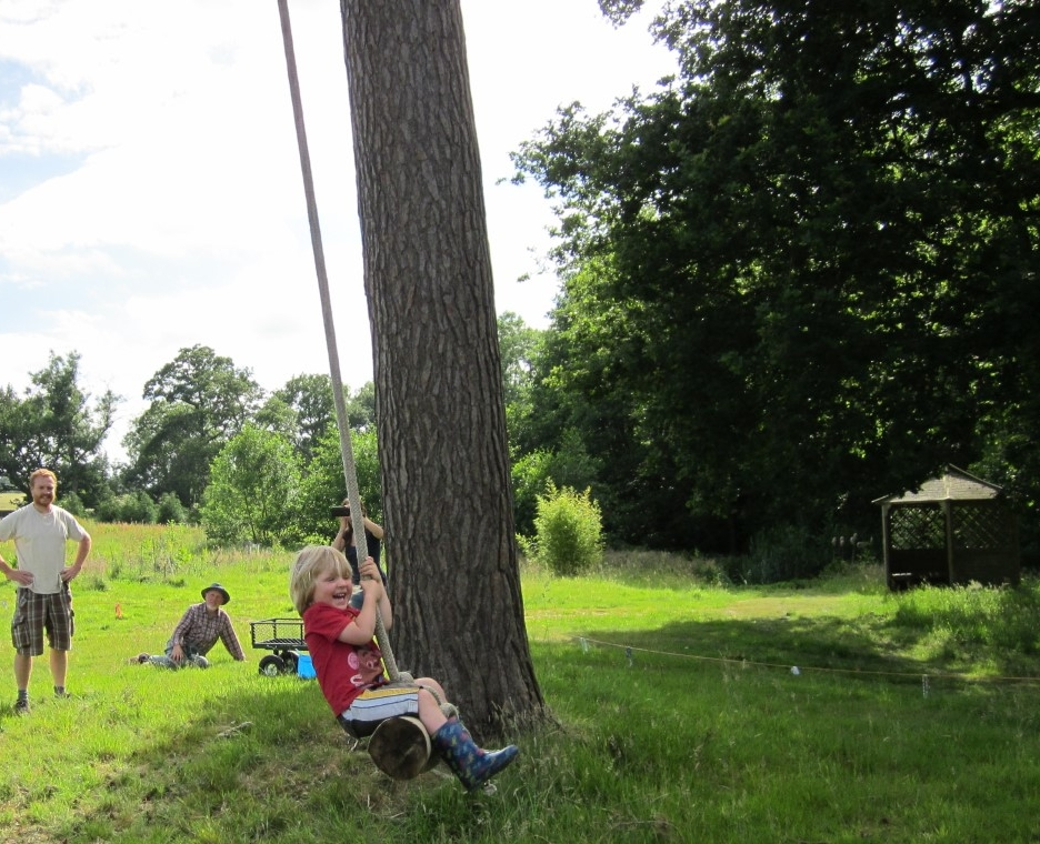 Elliot swinging from the new glamping tree swing
