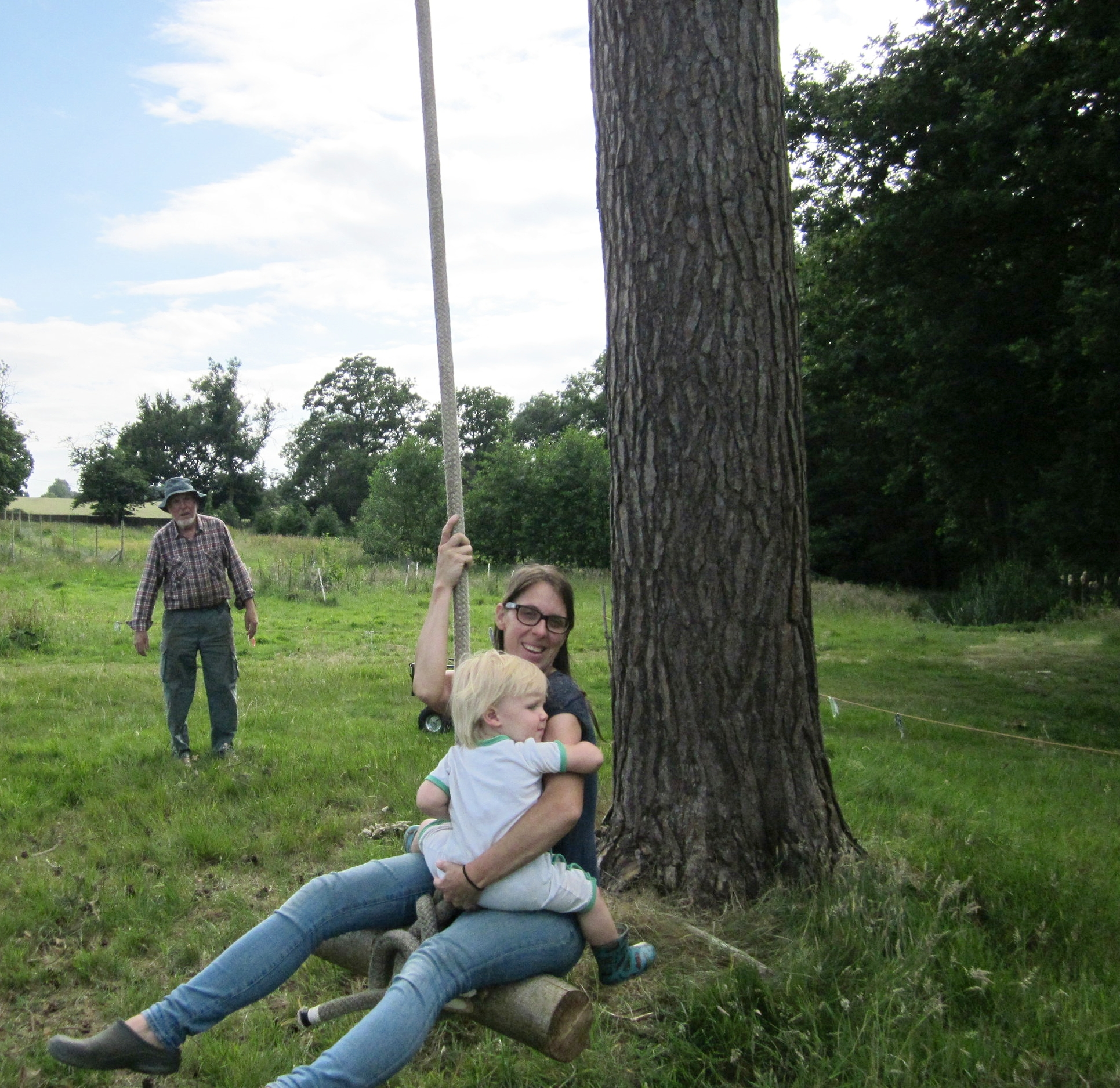 Kate & Dylan swinging from the glamping tree swing