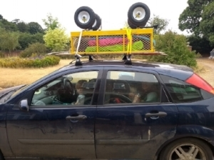 Trolley roofbox full of sleeping bags, a tent and camping chairs