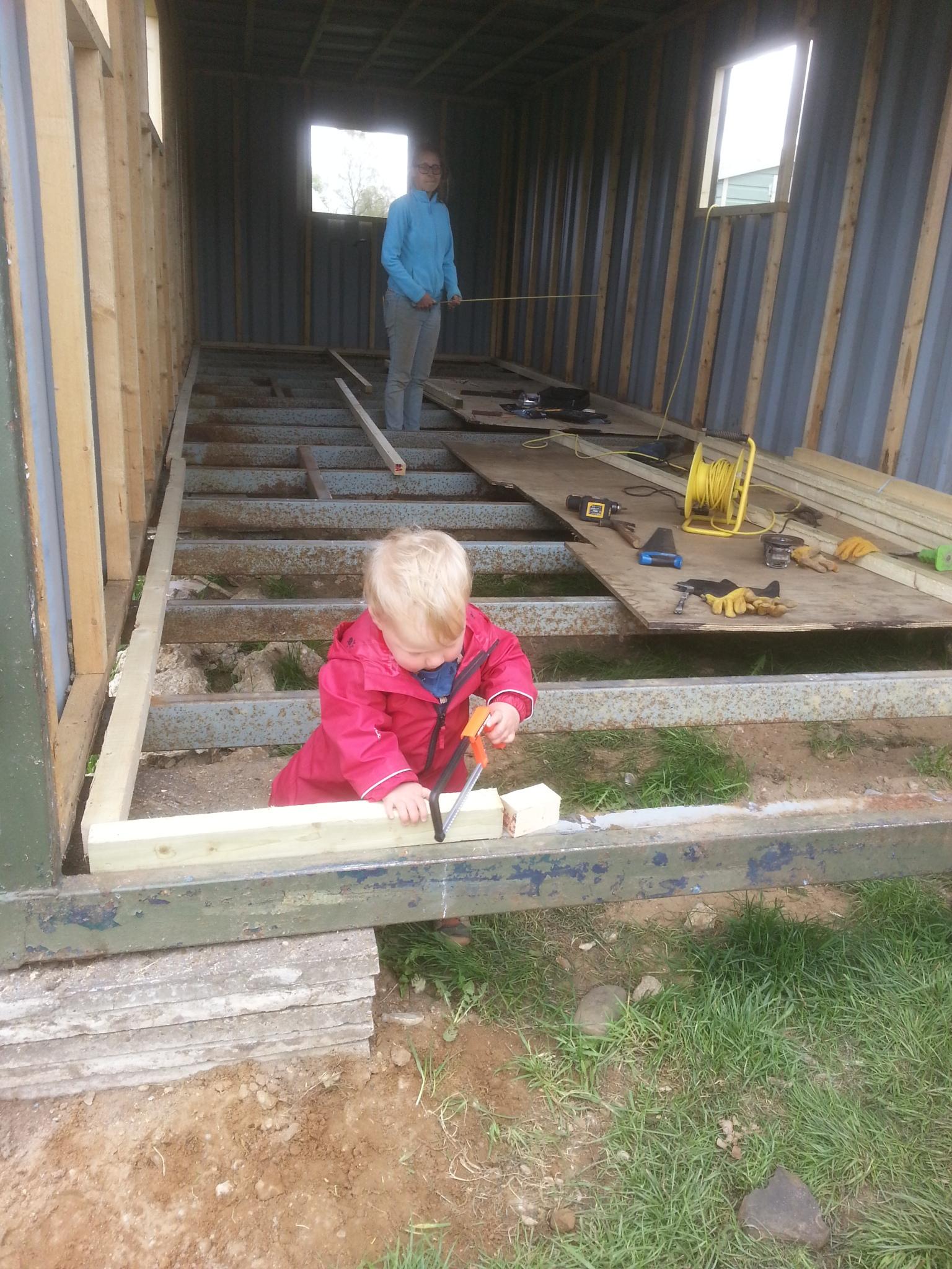 Elliot building the shower building floor