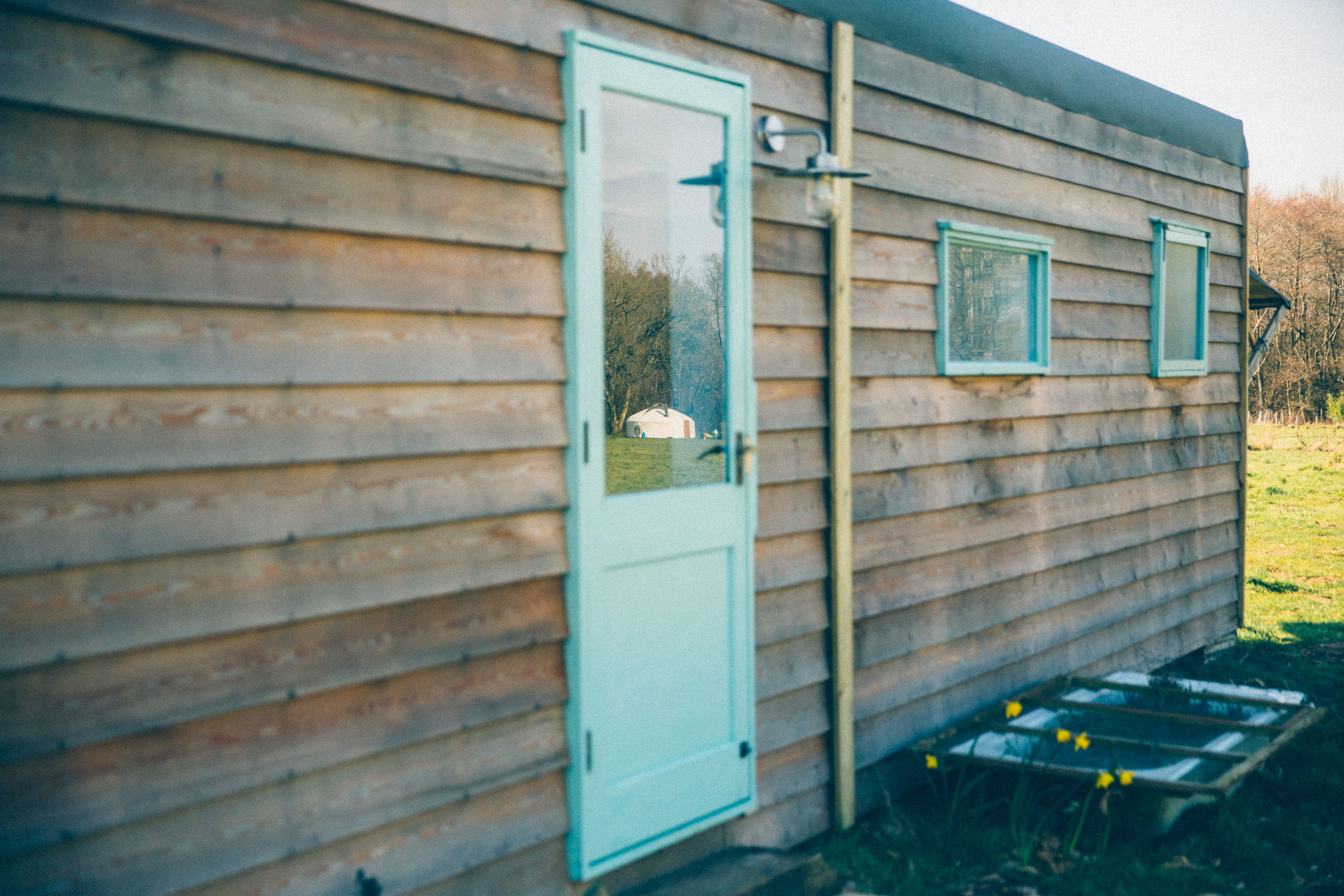Shipping container shower building conversion