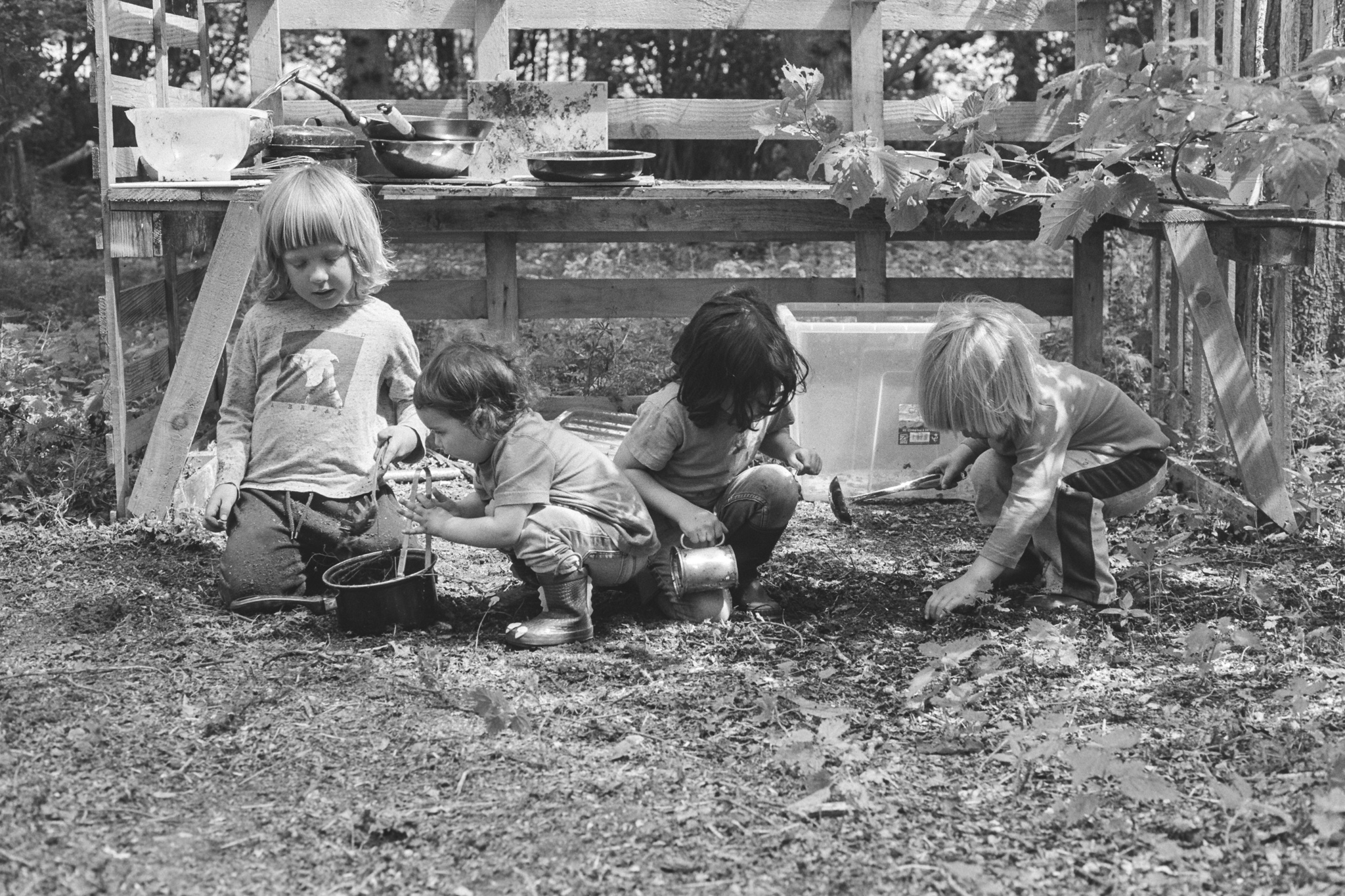 Mud kitchen playtime, natural play in the woods