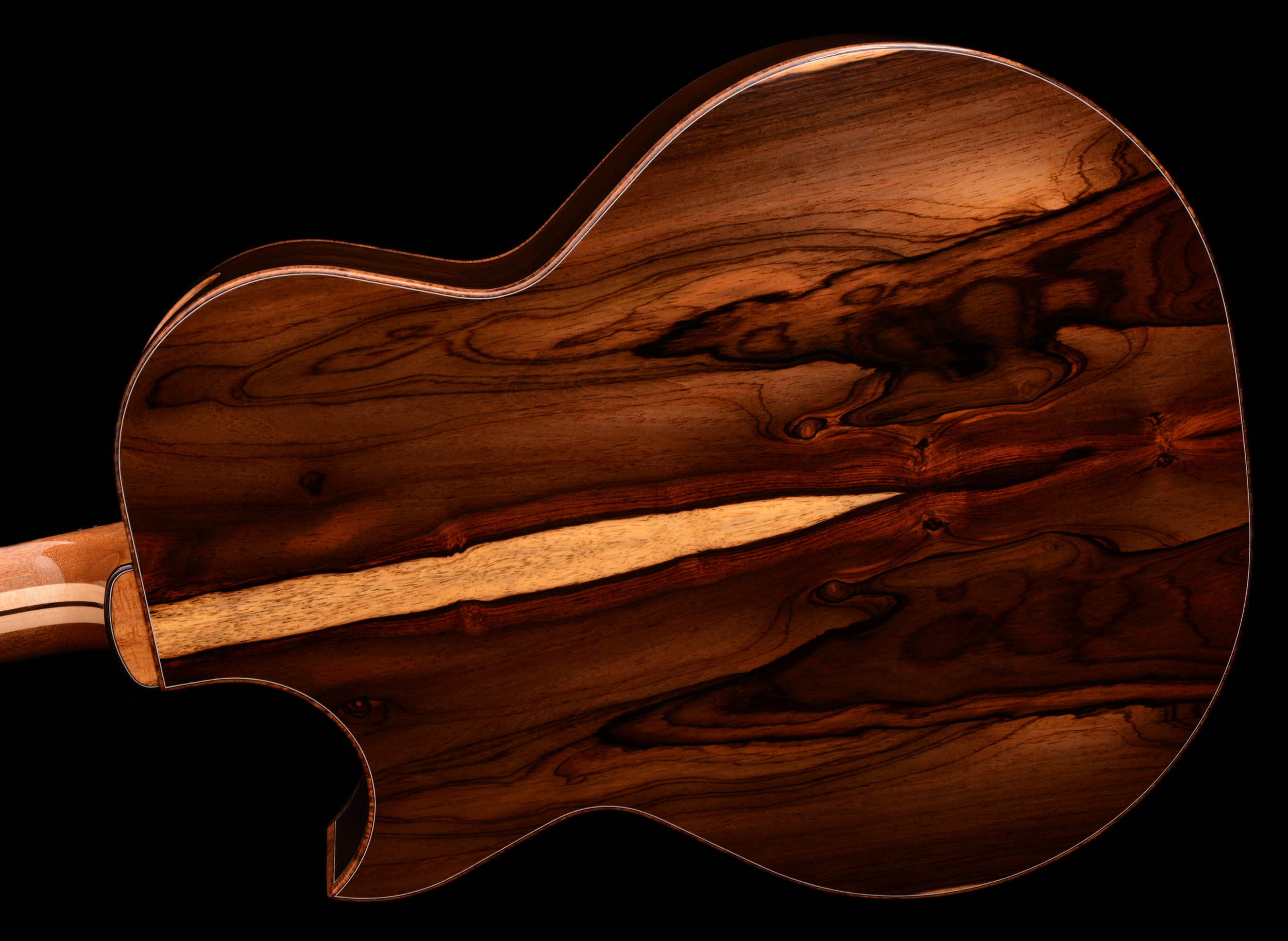 This Brazilian guitar is reflective of a Thomas Kinkade painting. It has areas with highlights that appeared to glow!