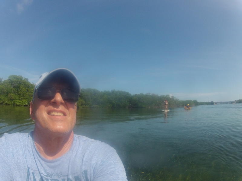 My dad taking a GoPRo selfie…me PADDLE BOARDING in the background. Woohoo!