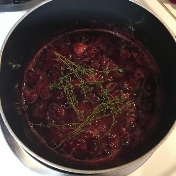 Here are the cranberries, water & sugar doing their thing. I added the thyme for a short time because I didn't want the thyme to overwhelm the flavor. Say that 5 times fast.