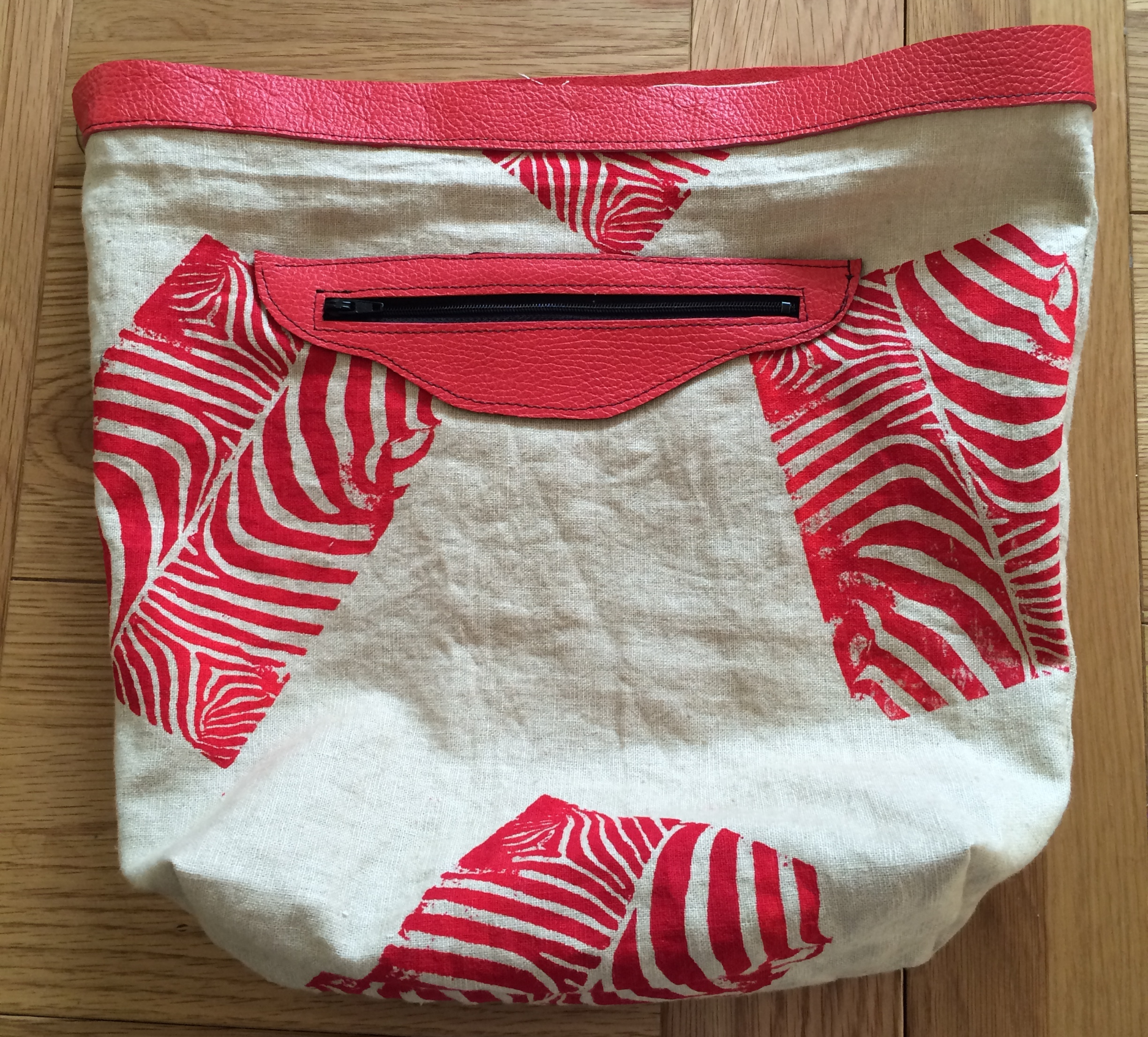 The lining of the bag, before the pom pom trim was attached, showing my hand printed zebra design and inside pocket detail.