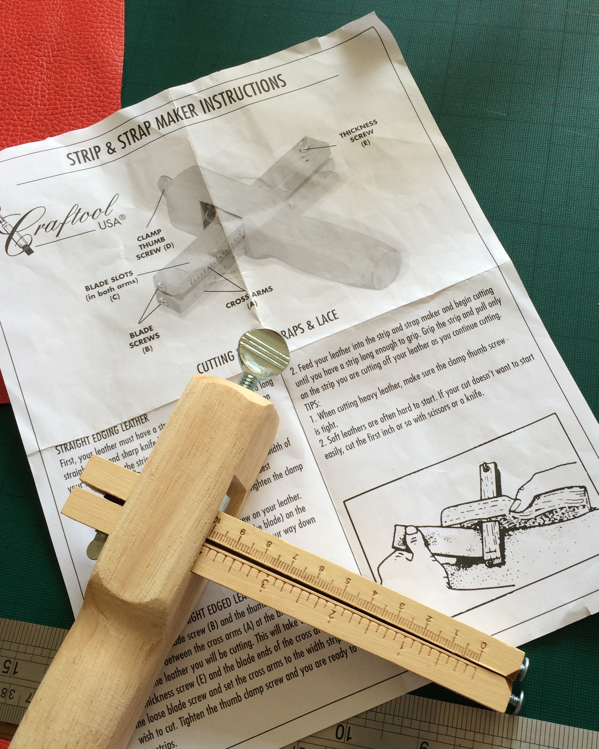 The fantastic strap cutter, which eliminates all the stress of cutting long strips accurately! You can just about see how it works from the bottom diagram on the instruction sheet.