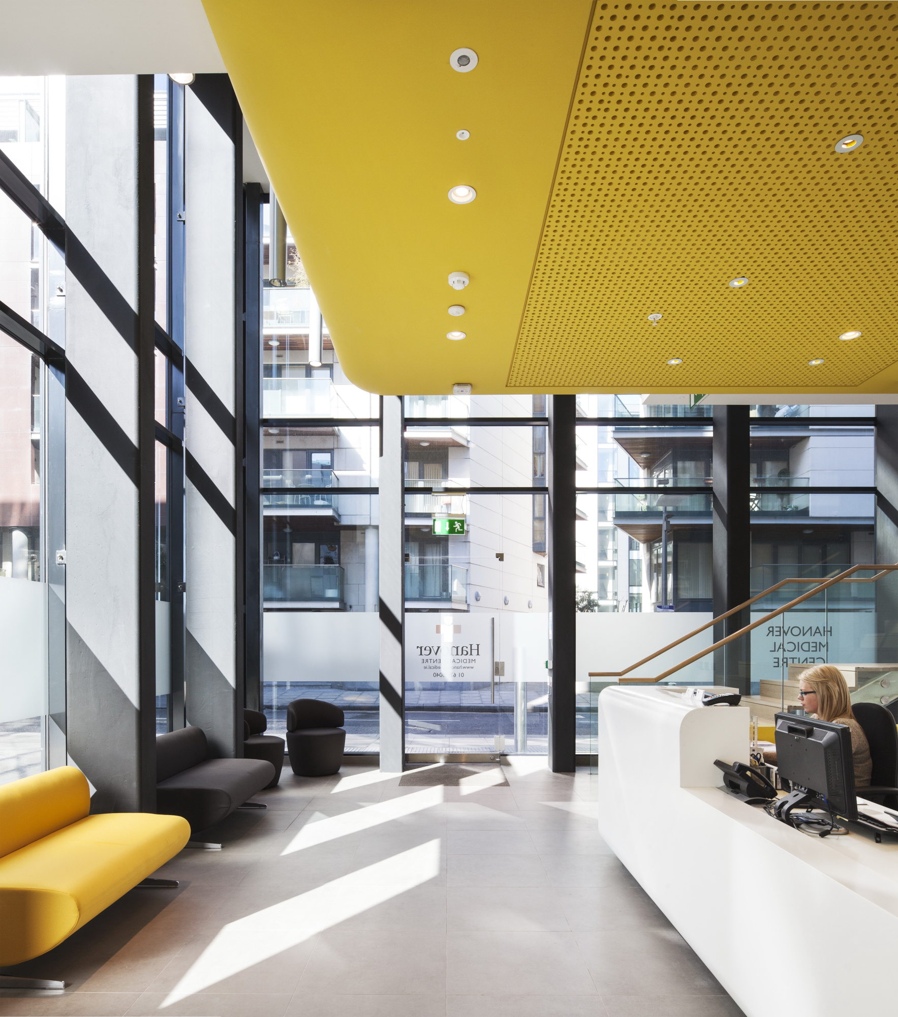 "- ""The architectural team listened carefully to our needs as providers of medical services and the result is a thoroughly modern, calming space that has flexibility and patient comfort at the centre of its design.A challenge of the site was the north facing aspect between tall buildings. The use of natural daylight and the bright, bold treatment of the curved edged mezzanine level have resulted in a space that patients comment on as 'welcoming' and 'cheerful'. Design features such as high levels of sound insulation between consulting rooms ensure maximum comfort for both staff and patients. The quality of the environment achieved reflects our objective to create a 'best of type' medical centre to meet the highest universal access and HIQA standards.""Client Testimonial"
