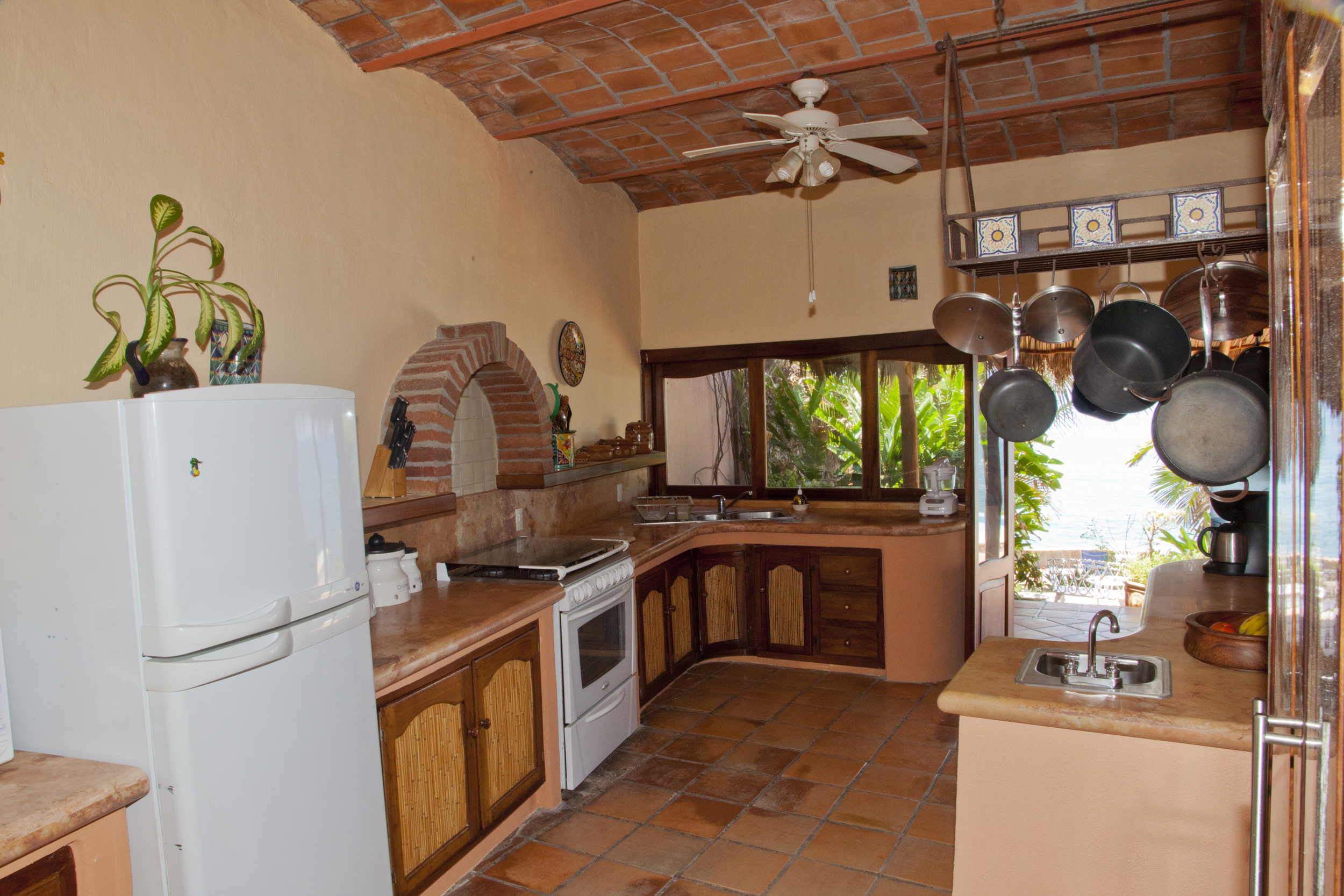 With granite counter tops, gas stove full size refrigerator, pass through windows and separate prep area with second sink, this kitchen can keep up with a family dinner or a full blown party.