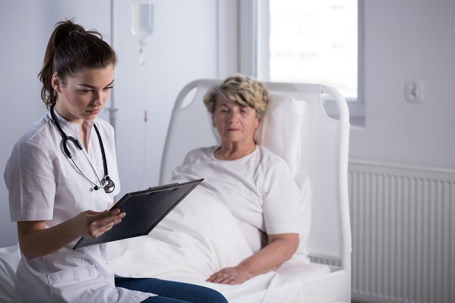 bigstock-Doctor-With-Elderly-Hospice-Pa-115354478.jpg