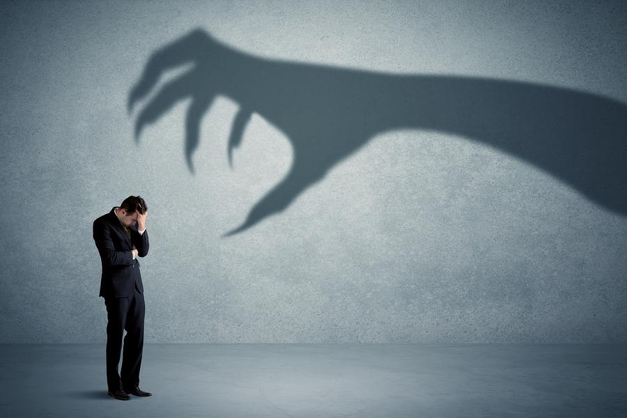 bigstock-Business-person-afraid-of-a-bi-187536745.jpg