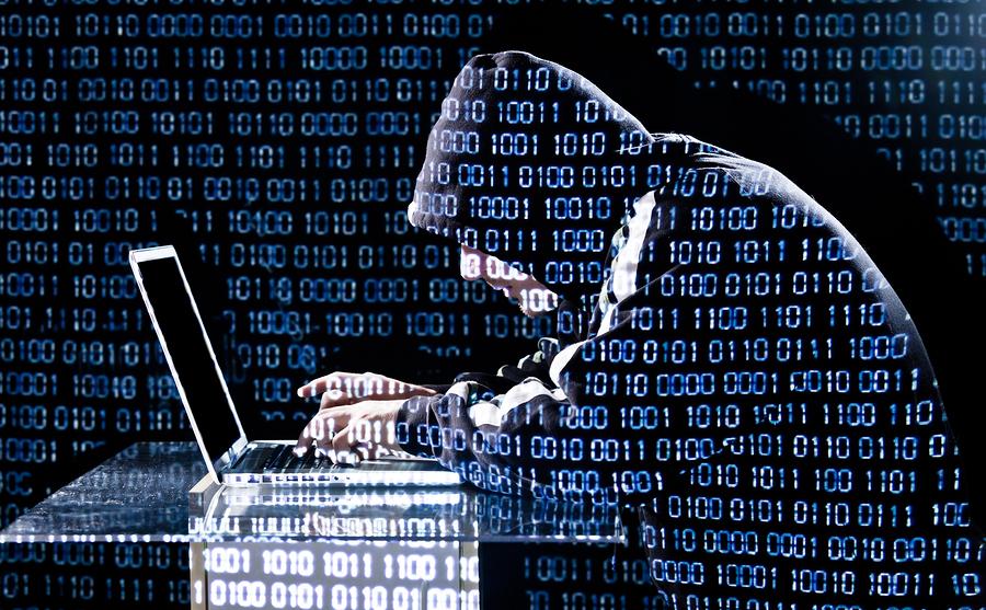 bigstock-Hacker-Typing-On-A-Laptop-44548564.jpg