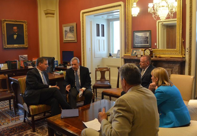rosenberg (left) meeting with durbin and other senators