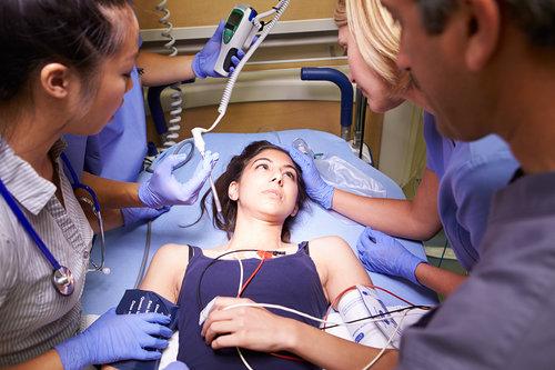 bigstock-Medical-Team-Working-On-Patien-55984199.jpg