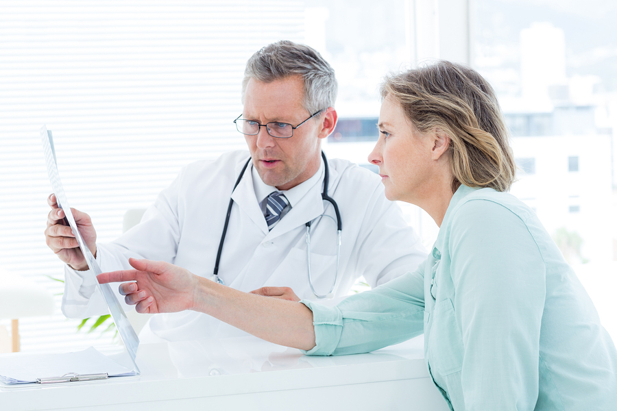 bigstock-Doctor-having-conversation-wit-89051804.jpg