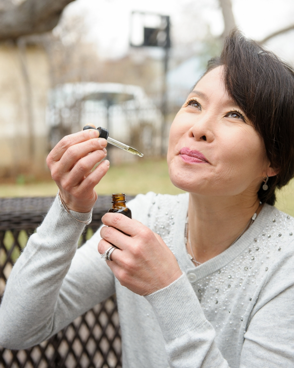 asian-female-ingesting-marijuana-tincture_6967.jpg