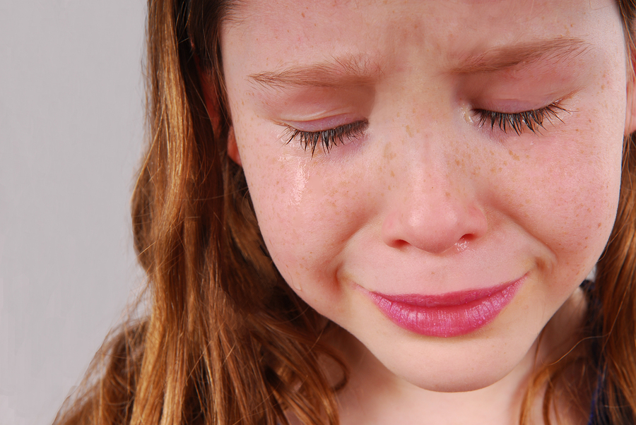 bigstock-Young-girl-upset-crying-with--25717613.jpg