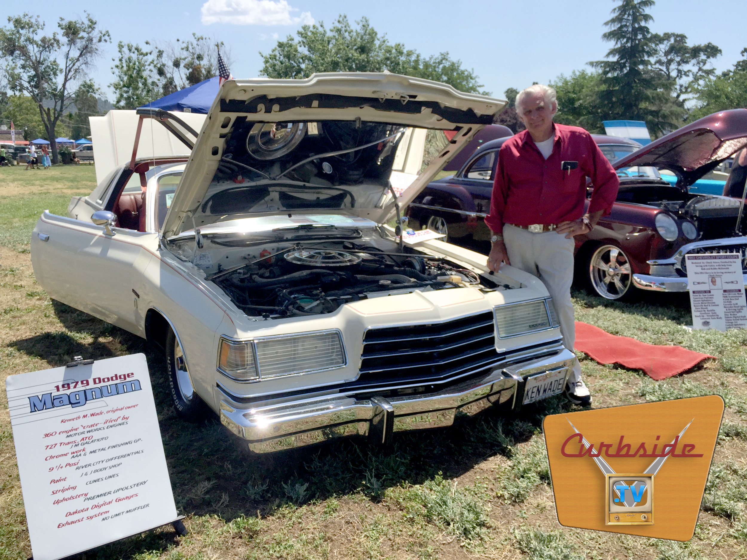 Ken Wade stands with his 1979 Dodge Magnum at a car show.
