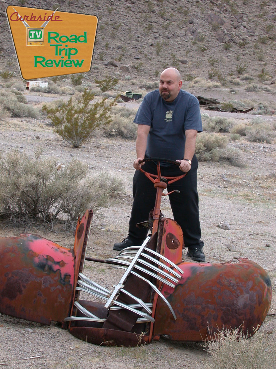Your Curbside publisher with one of the many pieces of cars that are rotting away in the desert climate.
