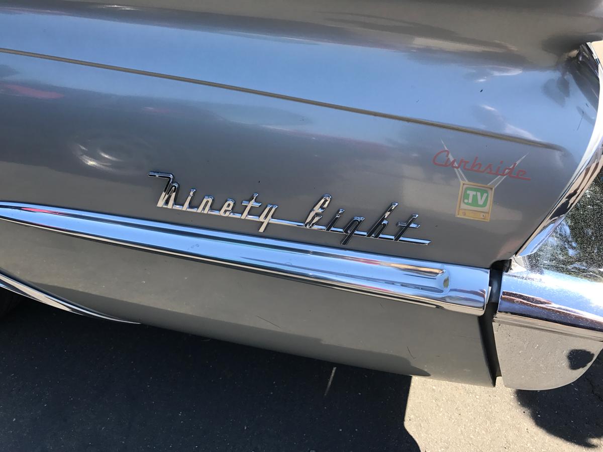 Olsmobile-98-1959-logo-script.png