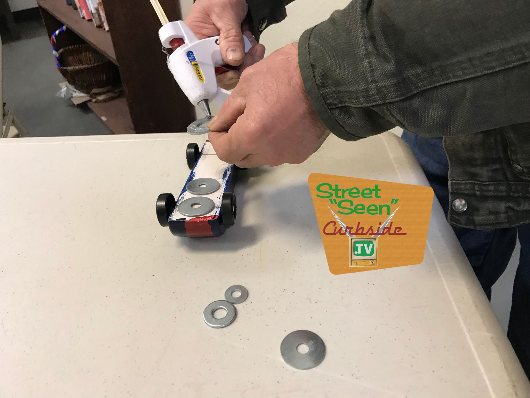 adding-weights-to-a-Pinewood-Derby-racer.jpg
