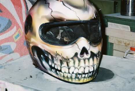 A custom-painted motorcycle helmet by Marvin Cox