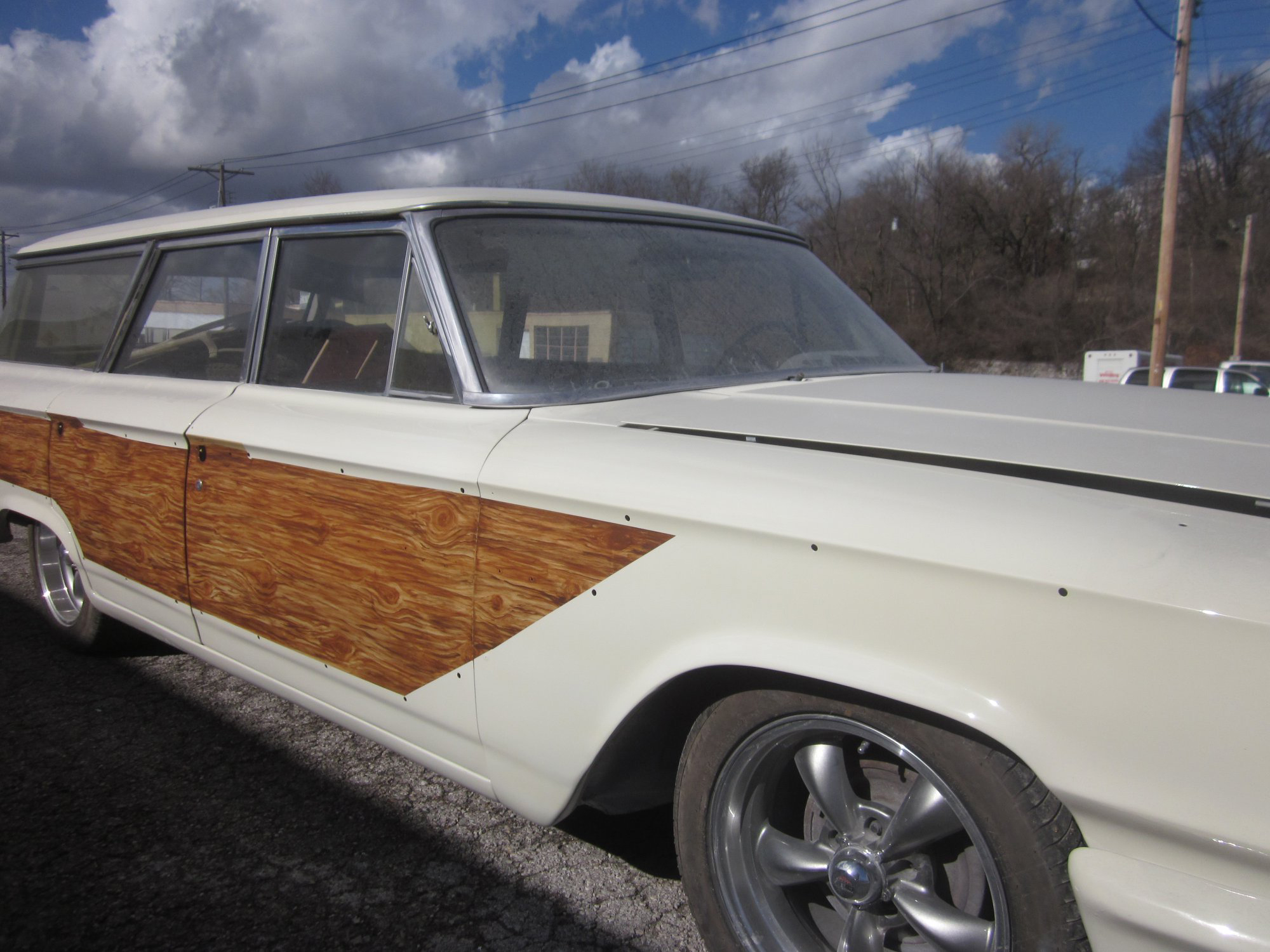 The customized woodgrain paint job is out and enjoying the sun