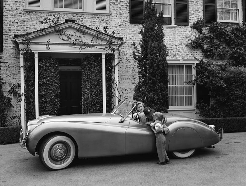 Actor Humphrey Bogart and his Jaguar XK-120