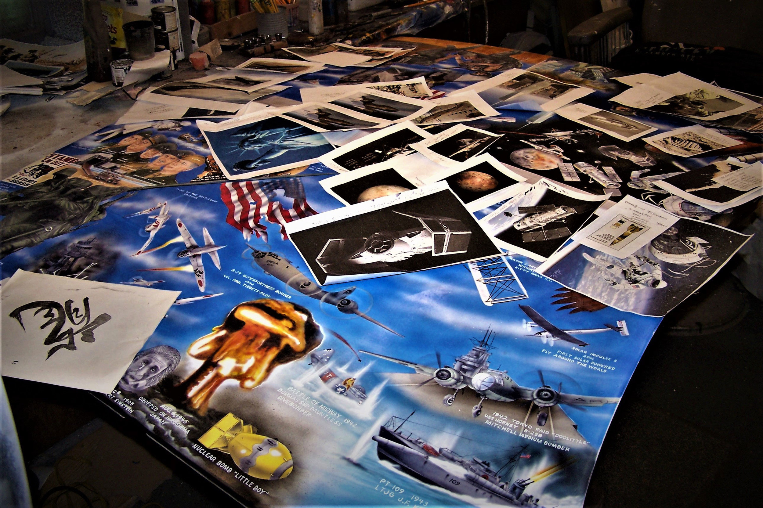 A huge number of photos and research goes into each of the drawings on the El Camino. Here the hood is being worked on with stacks of photos for research.