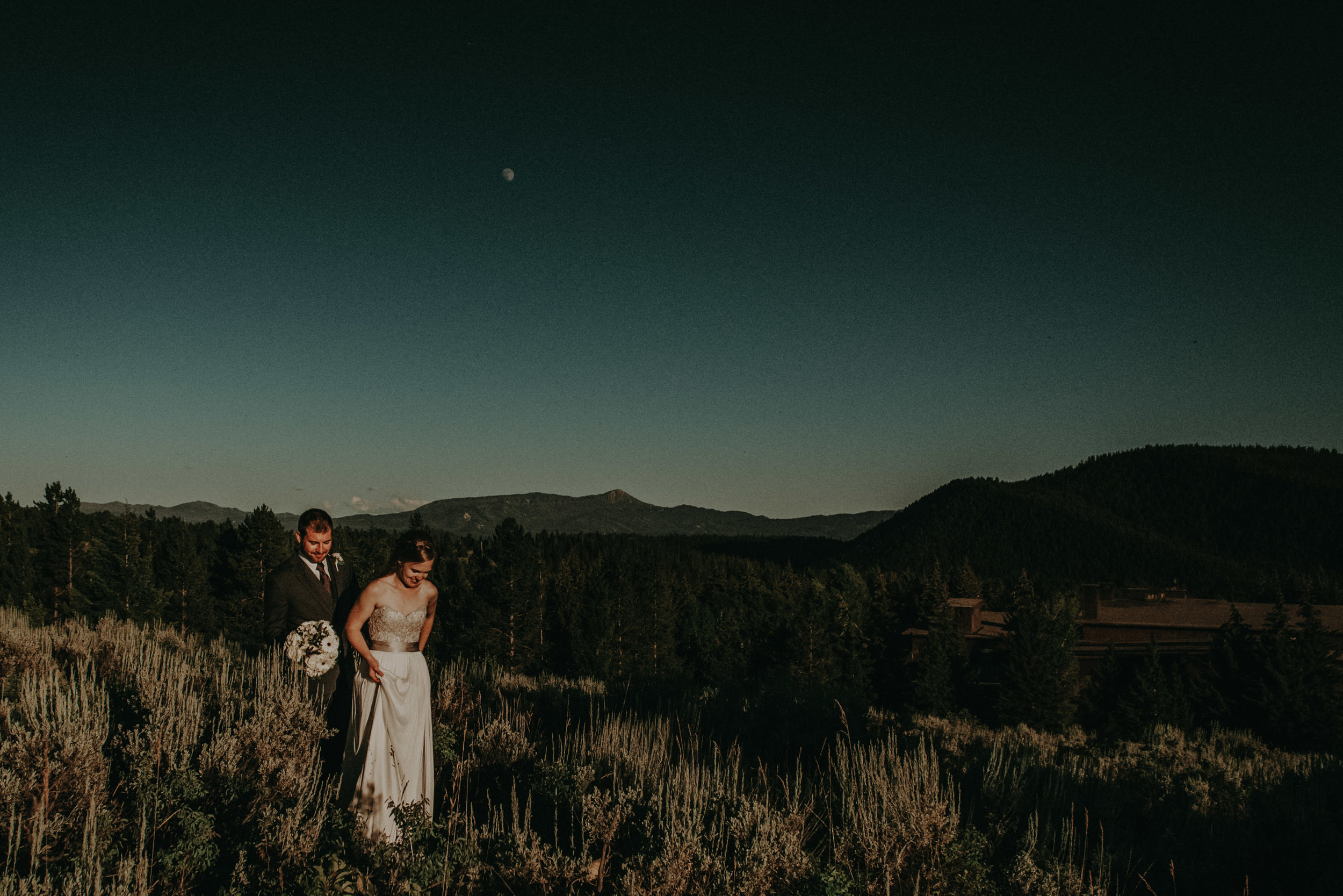The moon shining over the Grand Tetons and these newlyweds.