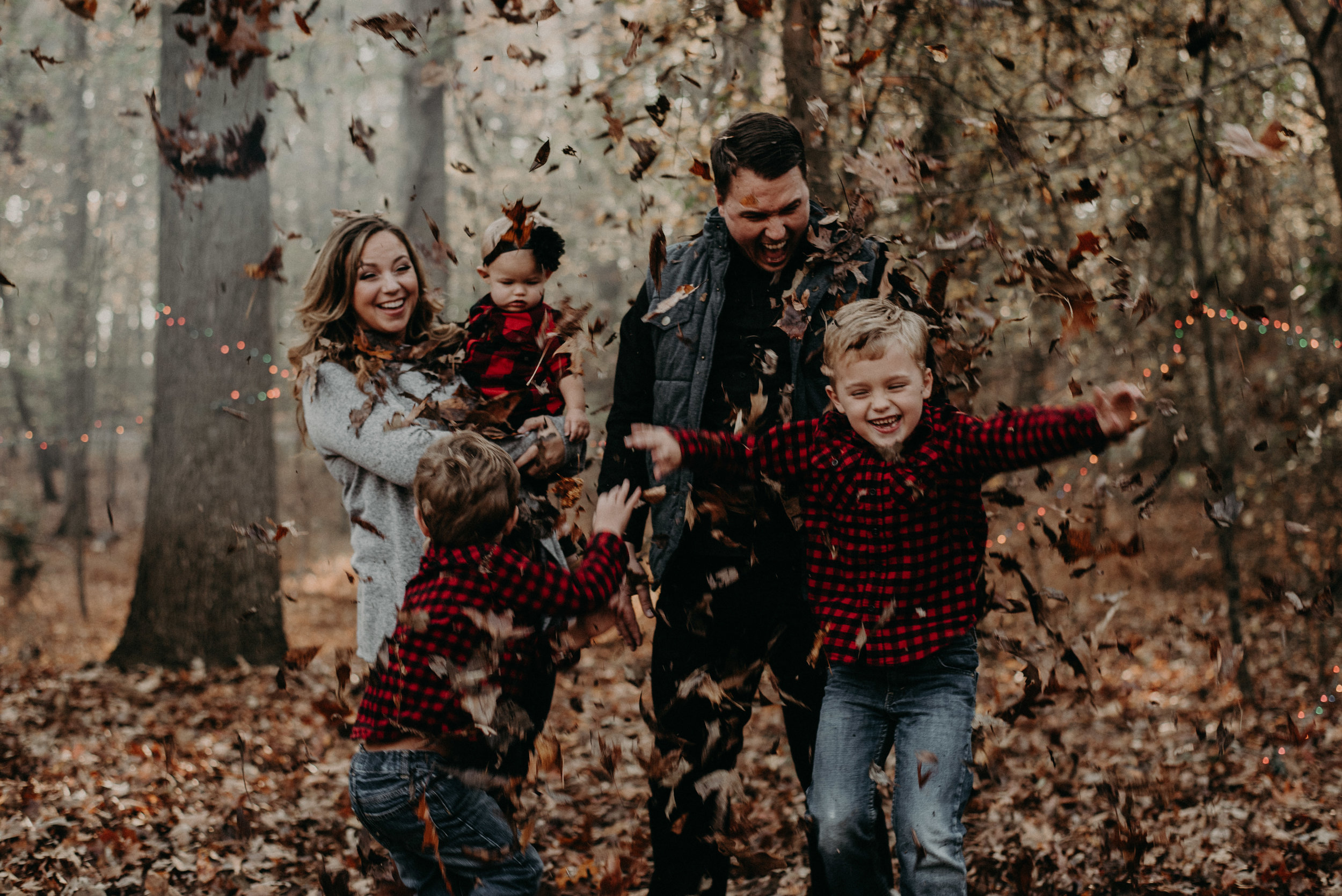 Family playing in leaves fall lifestyle session
