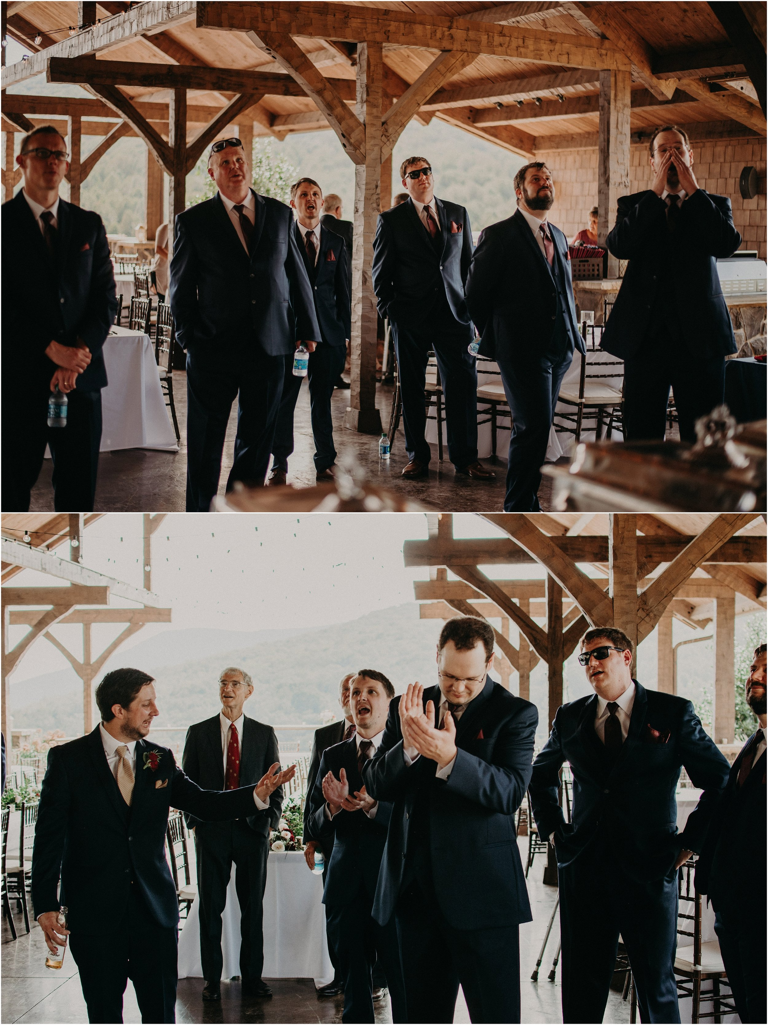 Groomsmen watching football game before wedding ceremony