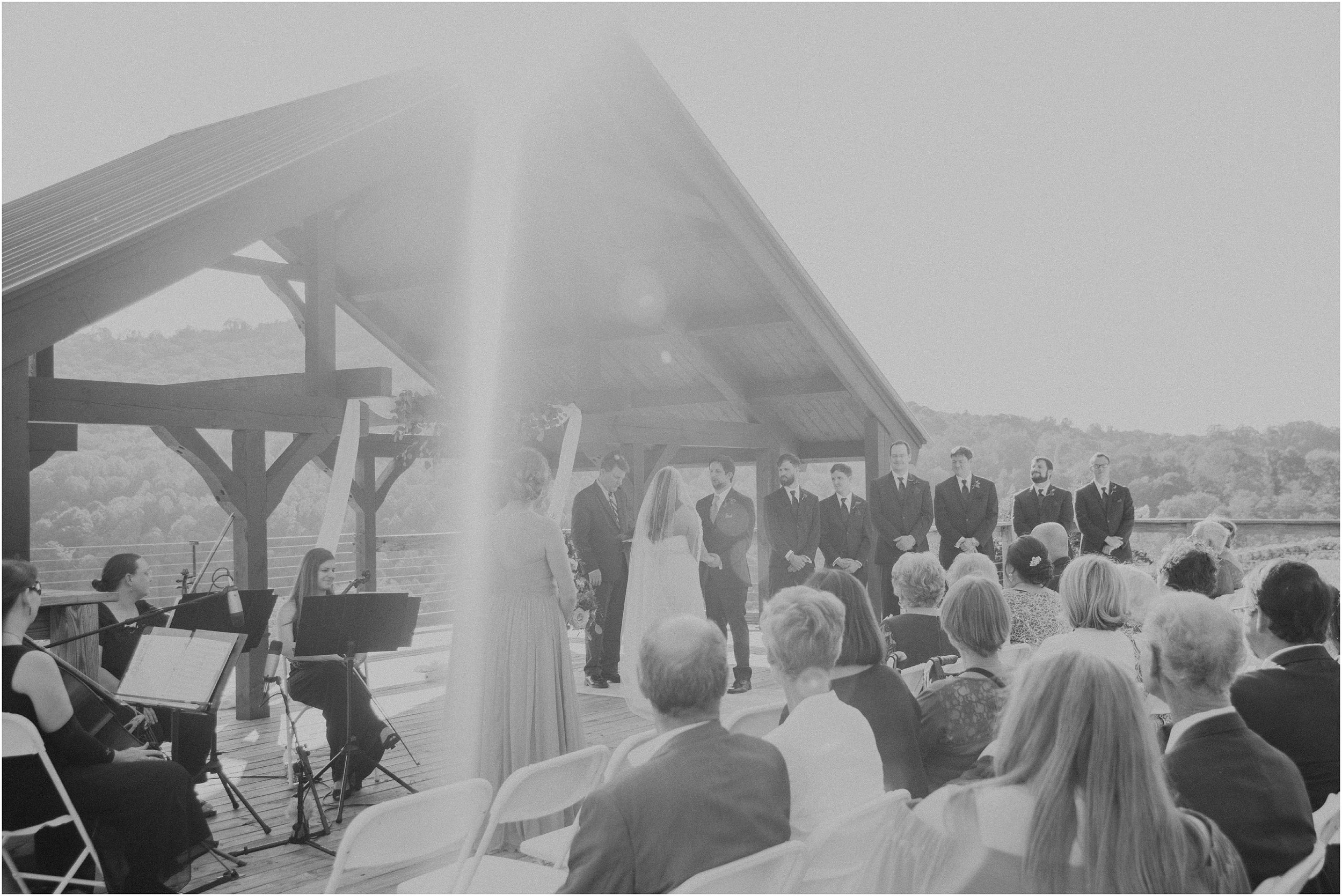 Sun flare over wedding ceremony at Debarge Winery in Lafayette, Georgia