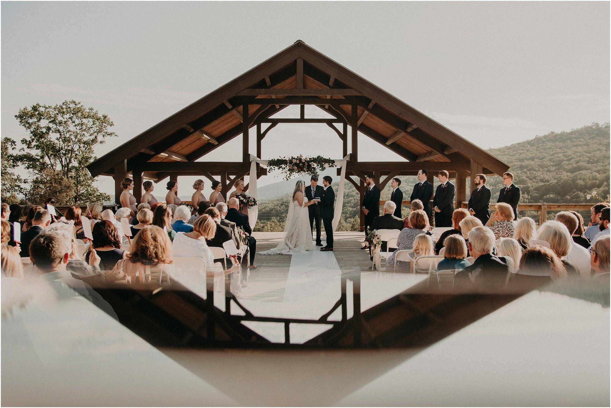 Fine art wedding ceremony image with reflection of deck arbor