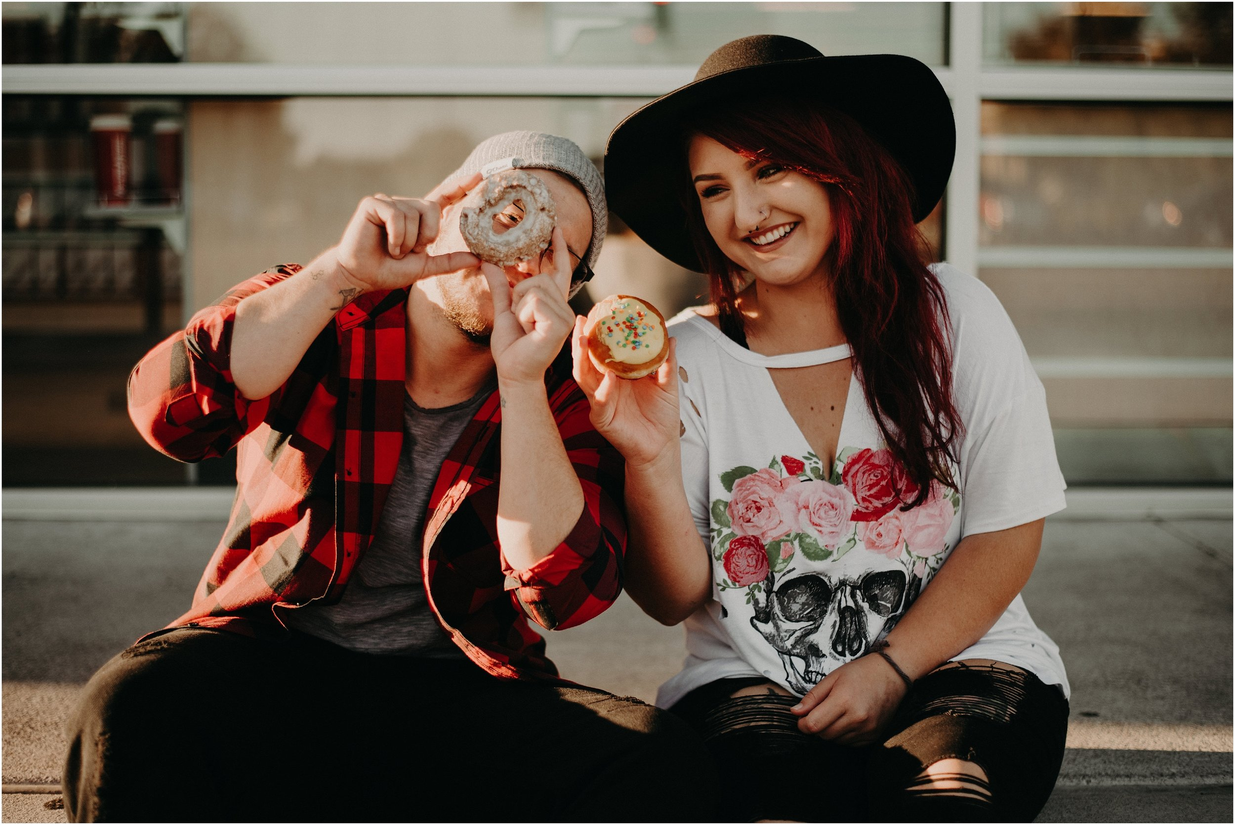Alternative and hip couple enjoy doughnuts together outside Krispy Kreme in Chattanooga, Tennessee