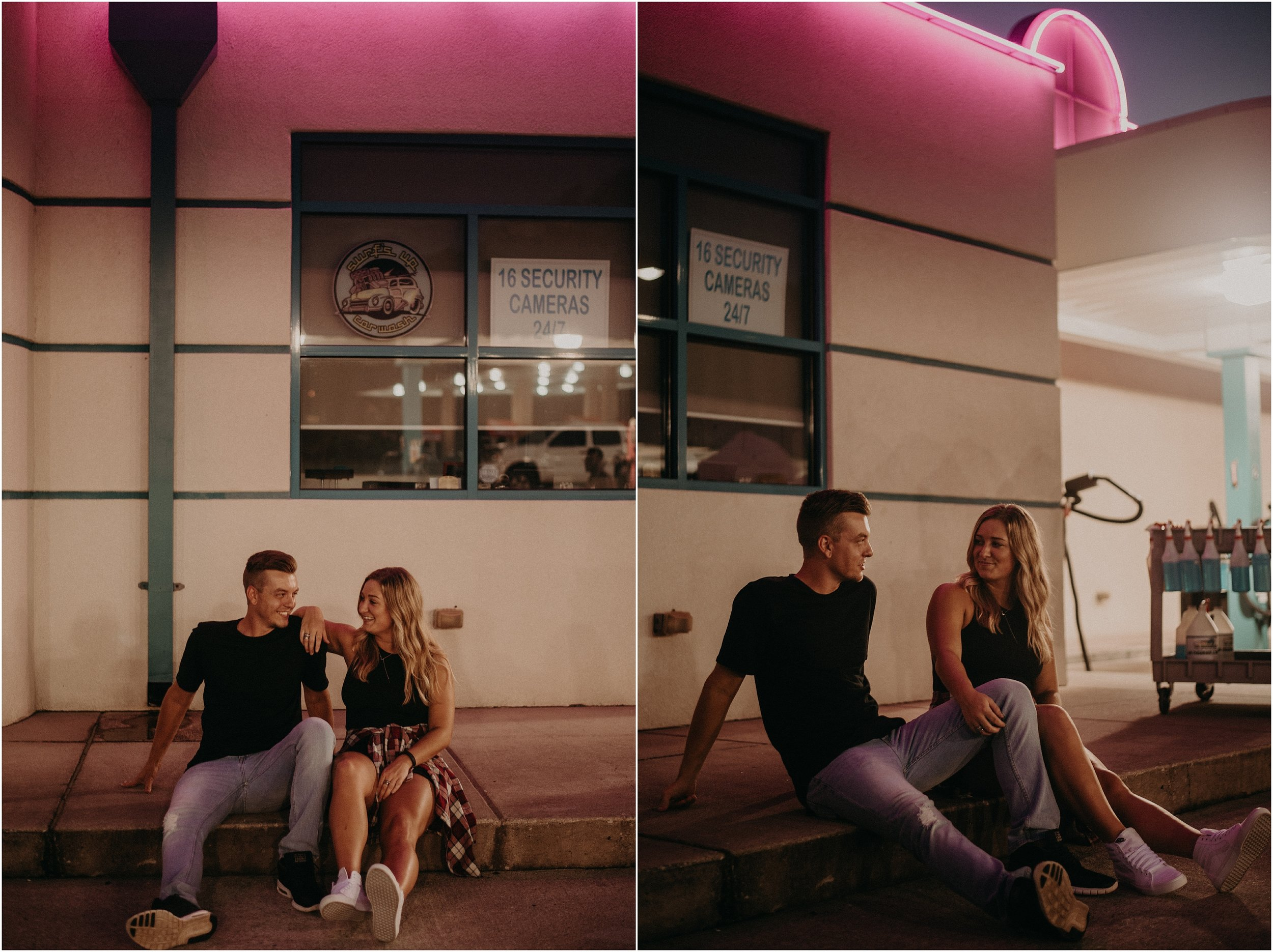 Hip couple hangs out beneath neon lights during a night time love story photo session