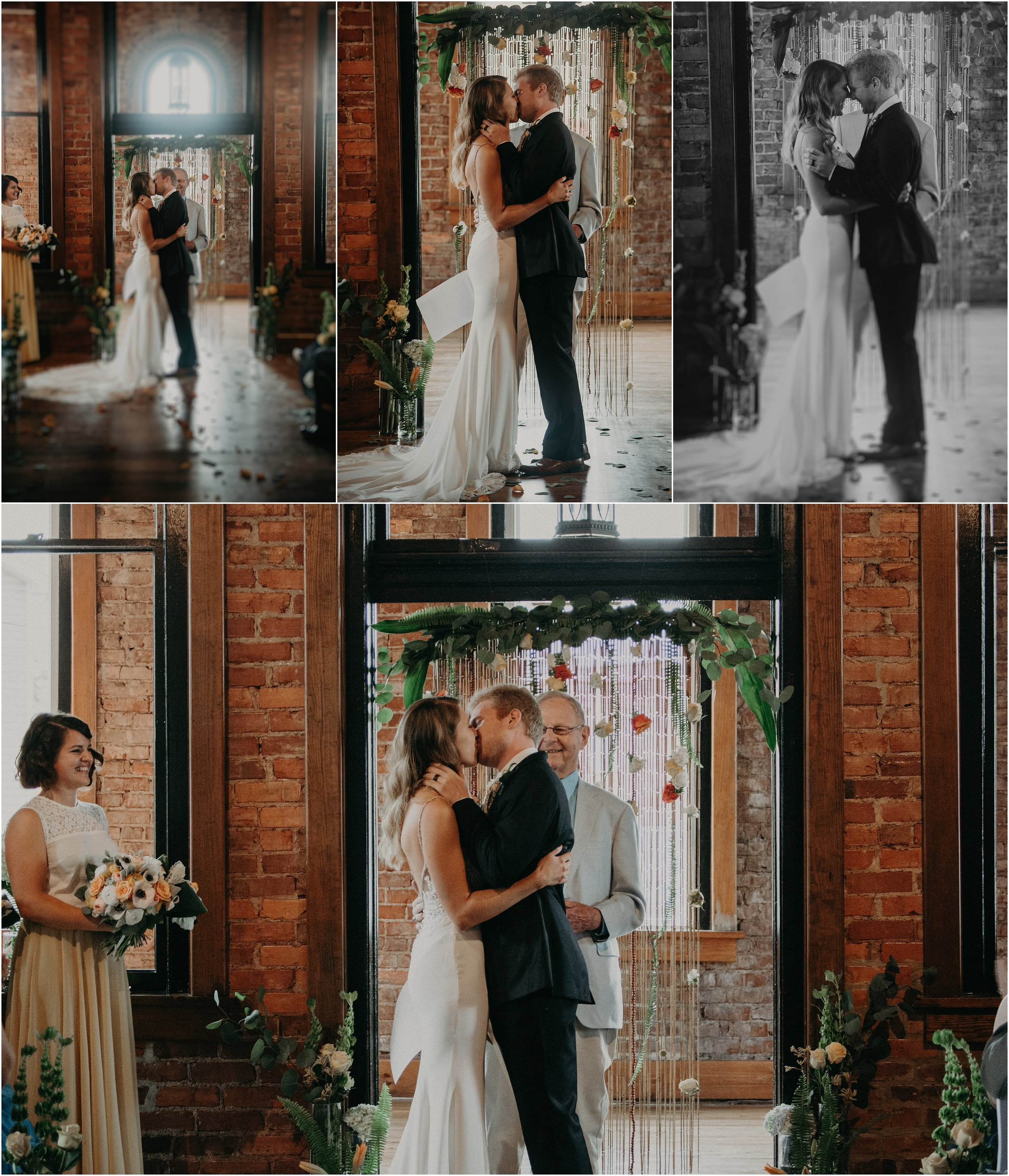 The bride and groom share their first kiss as husband and wife at the Church on Main in Chattanooga, Tennessee