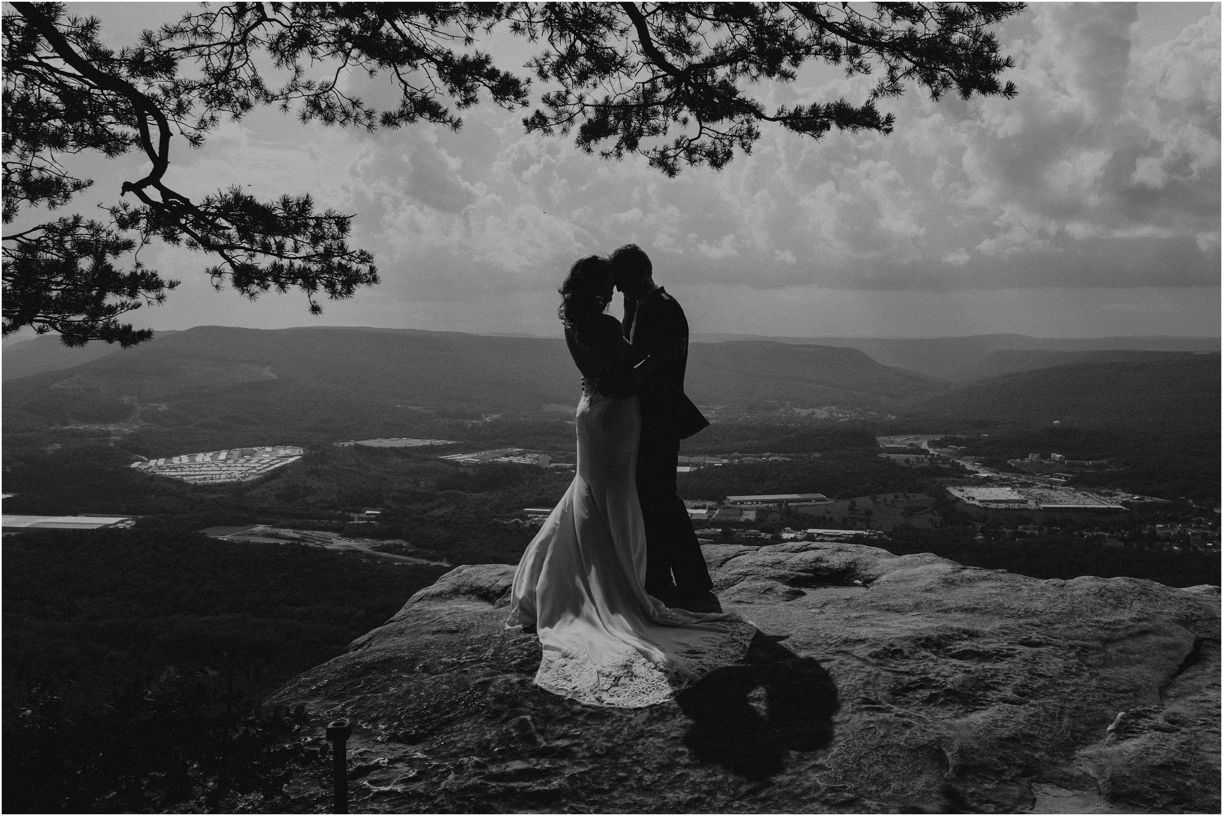 A dramatic sun-drenched black and white bridal portrait at Sunset Rock in Chattanooga, Tn