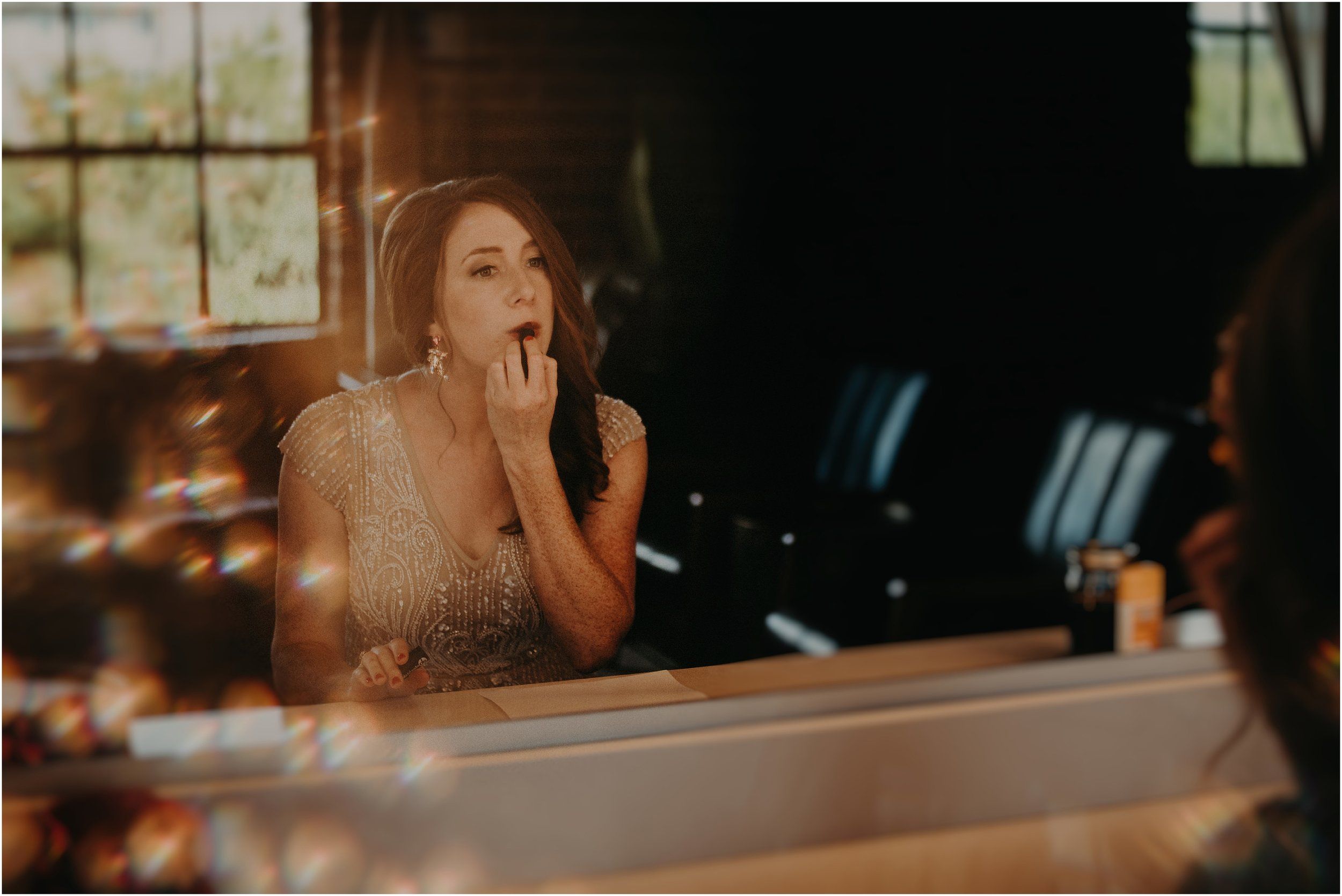 The bride applies her Elea Blake lipstick in this glamor shot