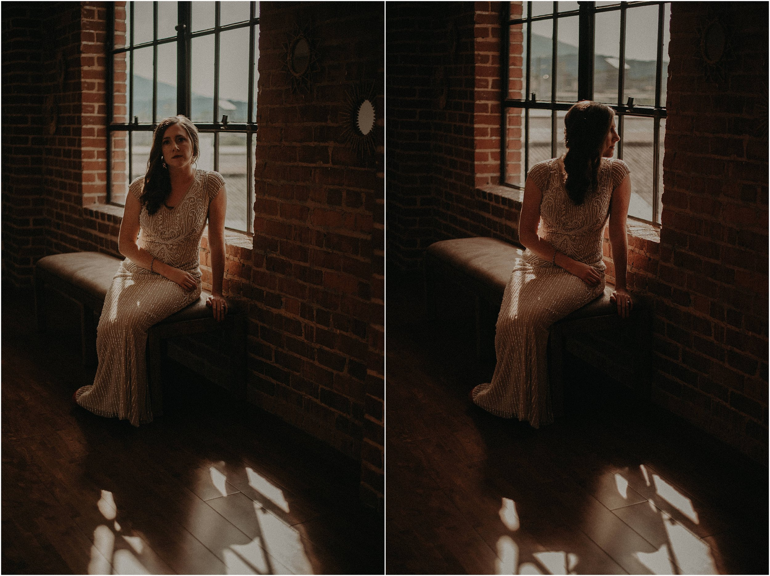 The sun streams through the window behind the bride in the hallway of The Turnbull Building