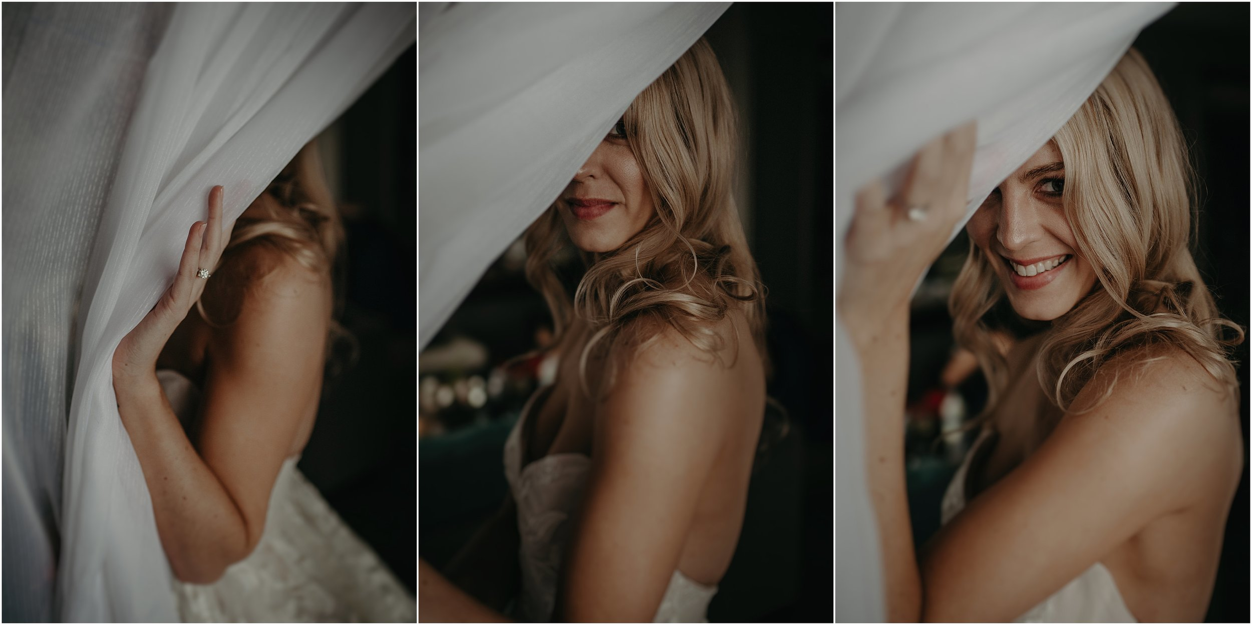 The bride peeks through the curtain's of the hotel room