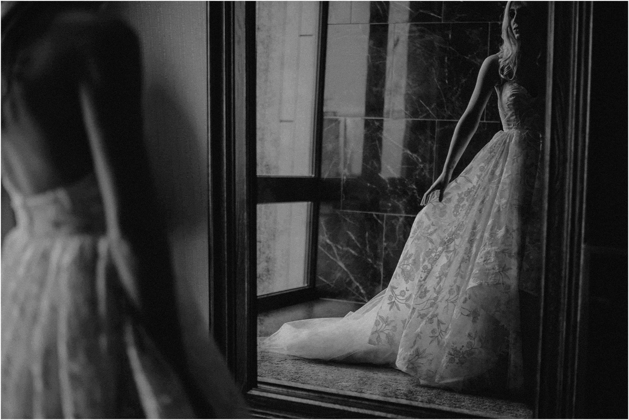 The bride watches her own reflection
