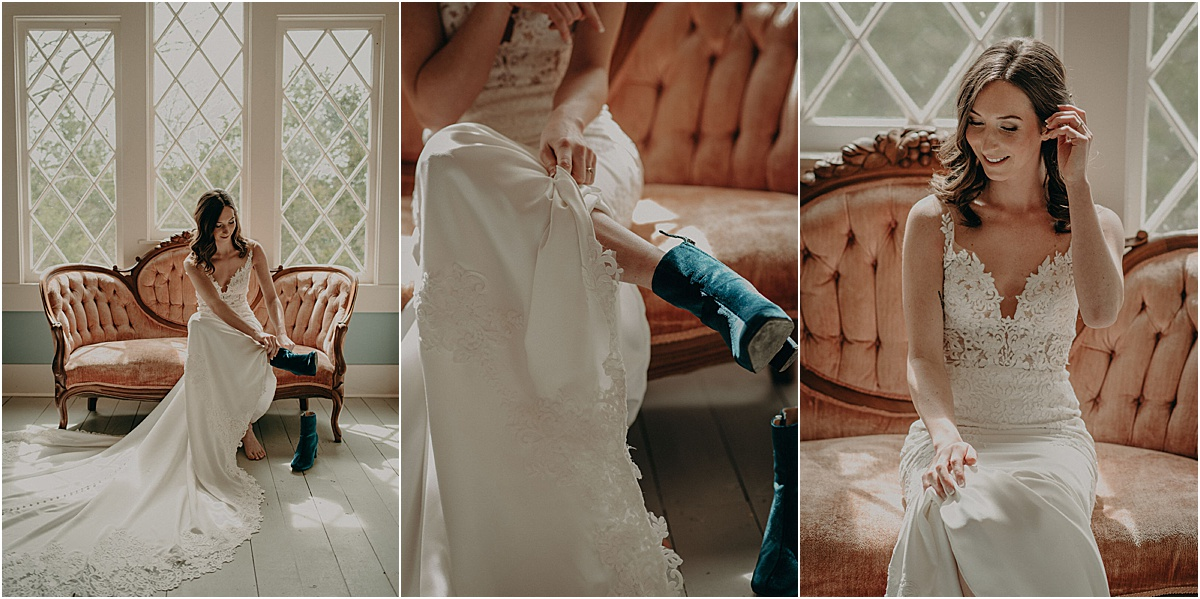 bride in white wedding dress putting on blue boots on antique couch