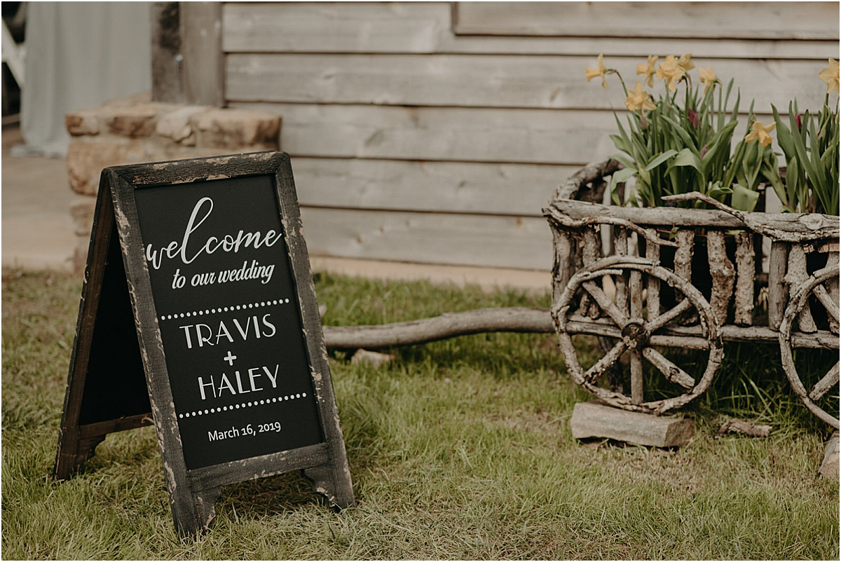 welcome to our wedding sign at rustic outdoor wedding ceremony